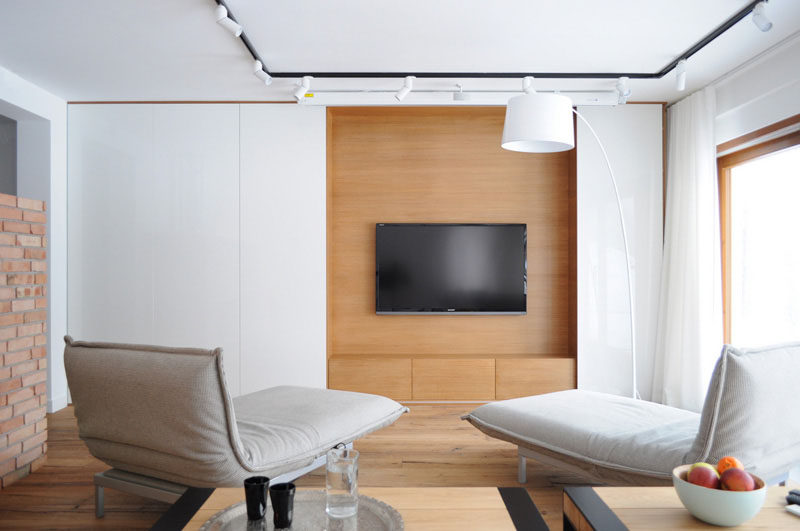 8 TV Wall Design Ideas For Your Living Room // The large TV in this minimal living room is the focal point in this room.