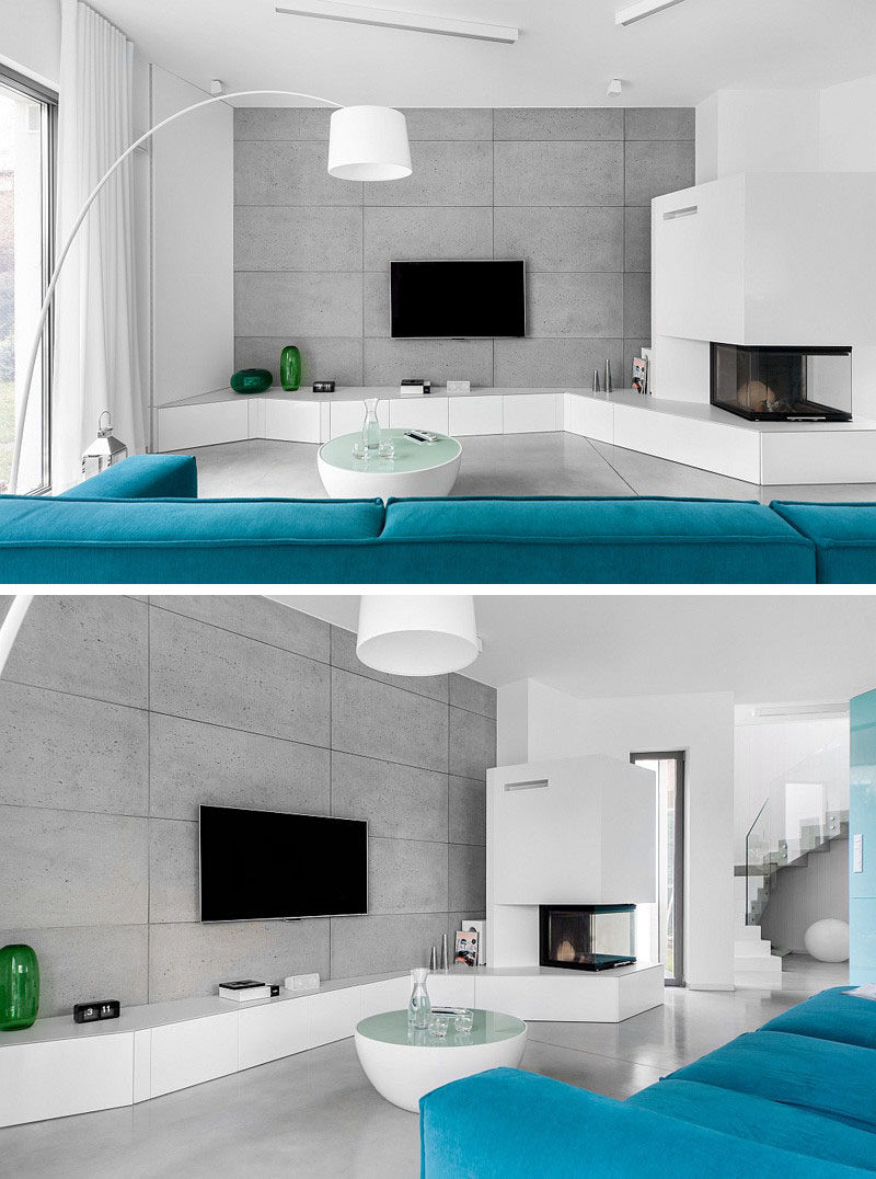 8 TV Wall Design Ideas For Your Living Room // The concrete wall behind the TV in this living room let the TV stand out and become the centre of attention.