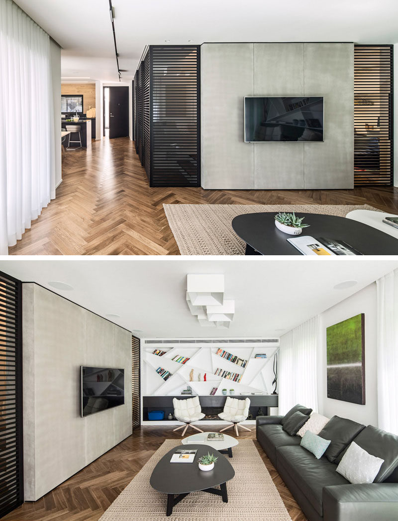 8 TV Wall Design Ideas For Your Living Room // The wall that the TV sits on in this home helps conceal the centrally located office and is surrounded only by the wall and shutters to make it easier to focus on what's going on on TV.