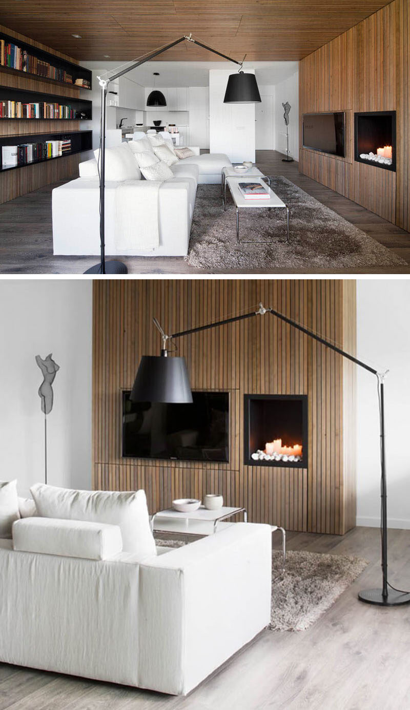 8 TV Wall Design Ideas For Your Living Room // Having your TV next to the fireplace also helps to create a cozy atmosphere that's perfect for enjoying a movie while cuddled up on the couch.