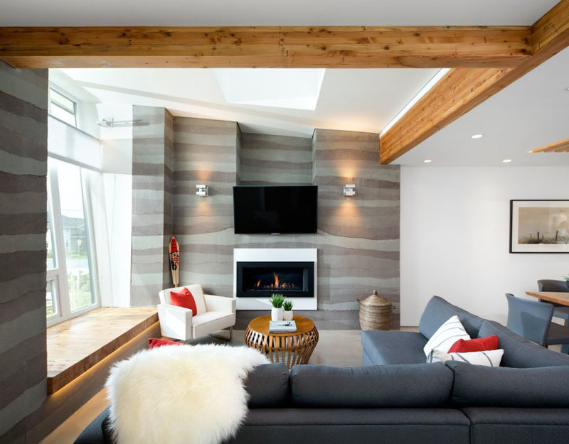 8 TV Wall Design Ideas For Your Living Room // This TV sits just above the fireplace to create a cozy viewing experience.