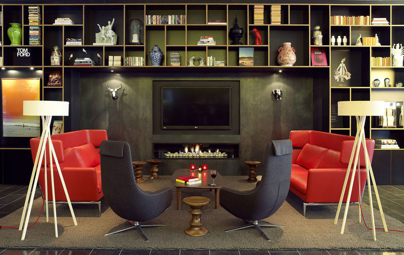 8 TV Wall Design Ideas For Your Living Room // A slightly recessed TV sits above this narrow fireplace creating a cozy atmosphere.