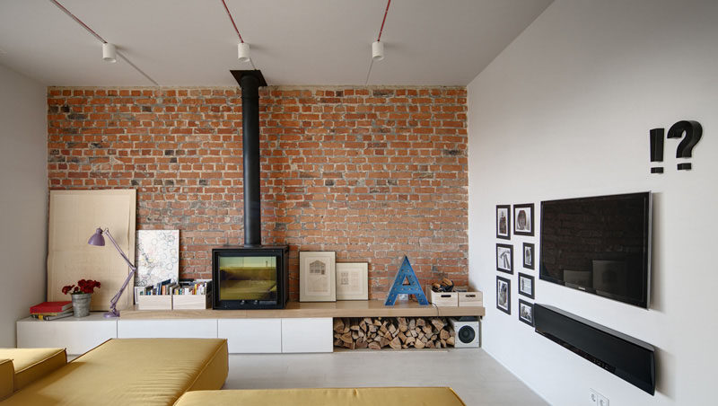 8 TV Wall Design Ideas For Your Living Room // The TV and soundbar hanging on this wall fit right in with the rest of the art on the wall.