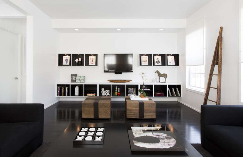 8 TV Wall Design Ideas For Your Living Room // The TV on this wall is has art on both sides to create a balanced look and turns the TV into a piece of art as well.