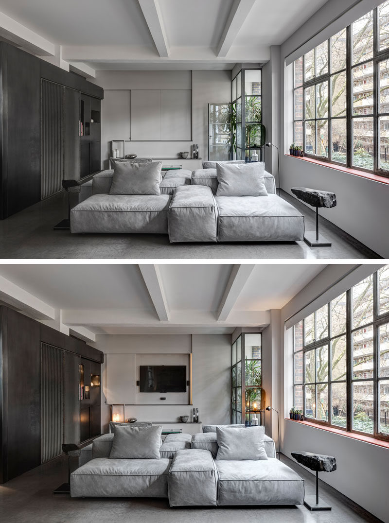 8 TV Wall Design Ideas For Your Living Room // This TV disappears completely behind a panel that blends right into the wall when it's closed up.