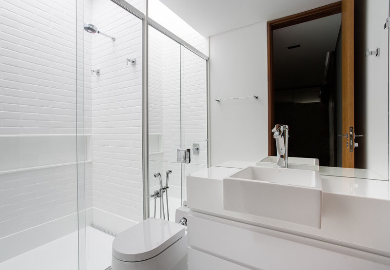 This white bathroom is just that, an almost pure white bathroom, with white vanity, white tiles and white toilet.