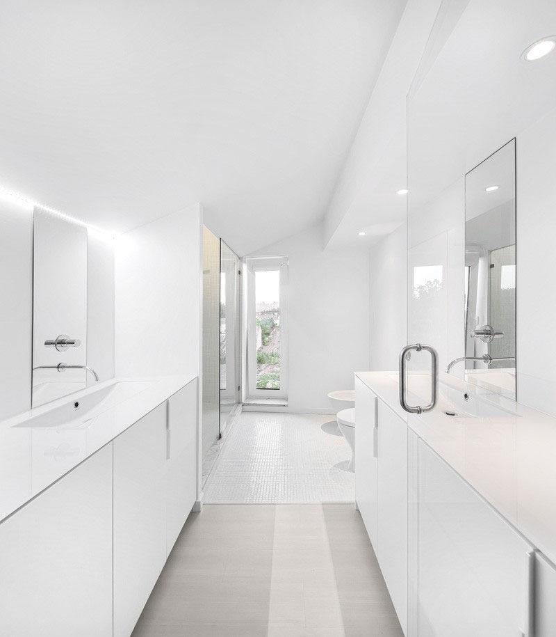 Bathroom Design Idea - Create a Spa-Like Bathroom At Home // Include crisp white walls.