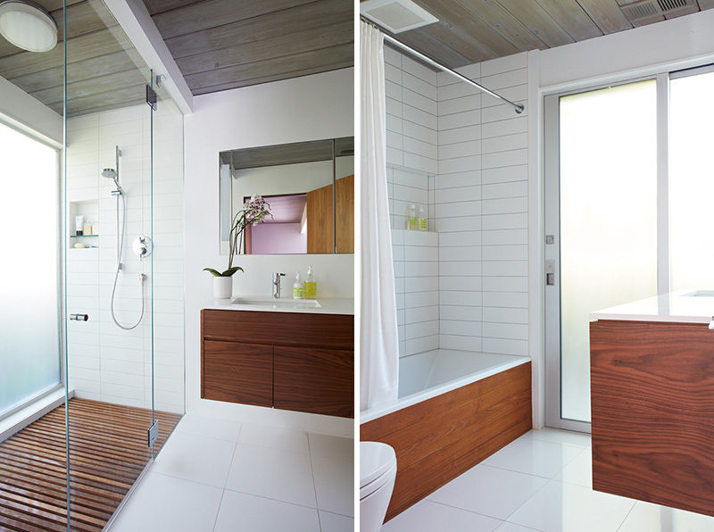 In the bathrooms of this remodeled mid century modern house, wood has been combined with white tiles on the walls and floor to create a clean contemporary look.