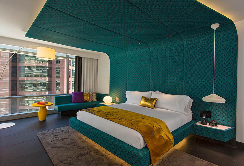Hotel Room Design Ideas To Use In Your Own Bedroom // Define the sleeping space with a wrap around headboard.