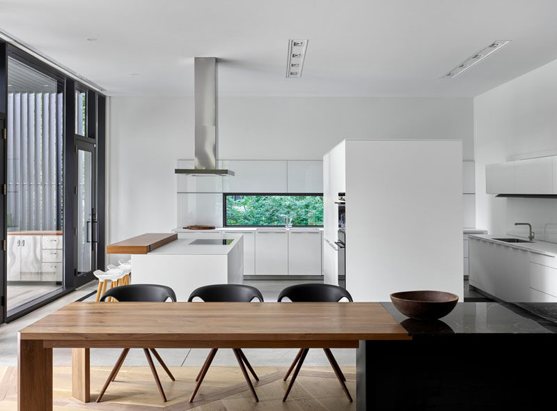 At this home the the mostly white kitchen was modeled after the look and feel of a showroom kitchen.