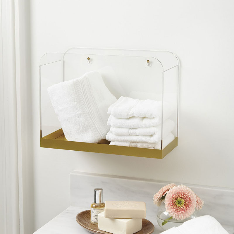 5 Ways To Use Acrylic Decor Throughout Your House // Bathroom - A gold bottom on this acrylic wall bin gives it an elegant look while still keeping it simple and stylish.