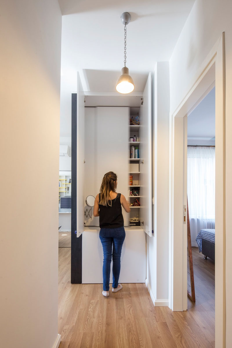 In this apartment, a closet at the end of the hallway creates much needed extra storage space.