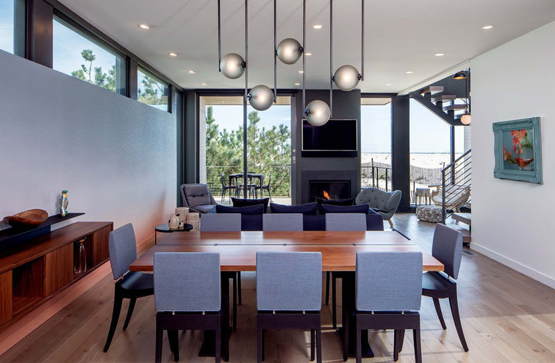 Above this dining table, a sculptural lighting fixture by Ladies and Gentlemen Studio, anchors the dining table in the open floor plan.