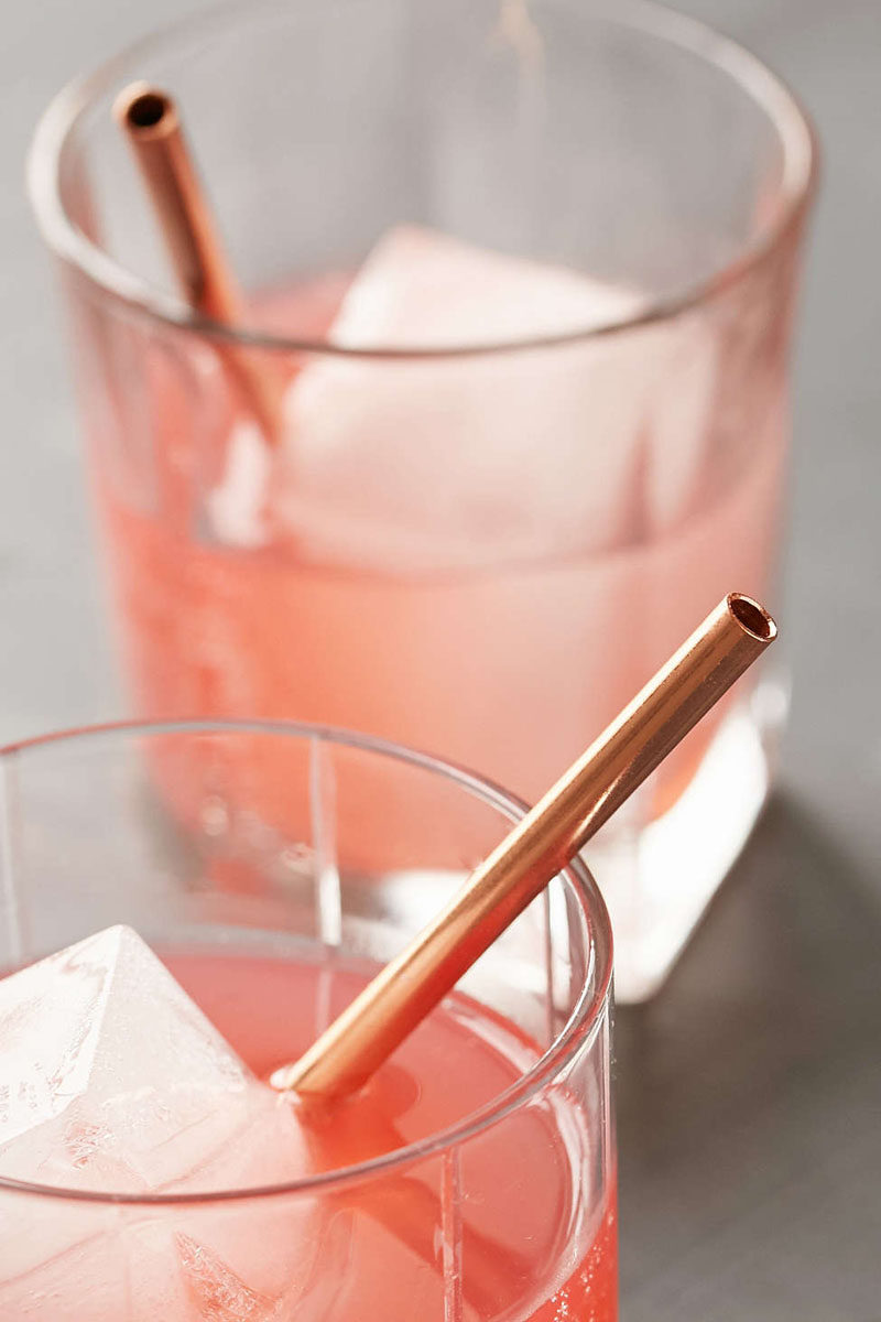 Kitchen Decor Ideas - 12 Ways To Add Copper To Your Kitchen // Reusable copper straws are both a stylish and environmentally friendly way to sip your drinks.