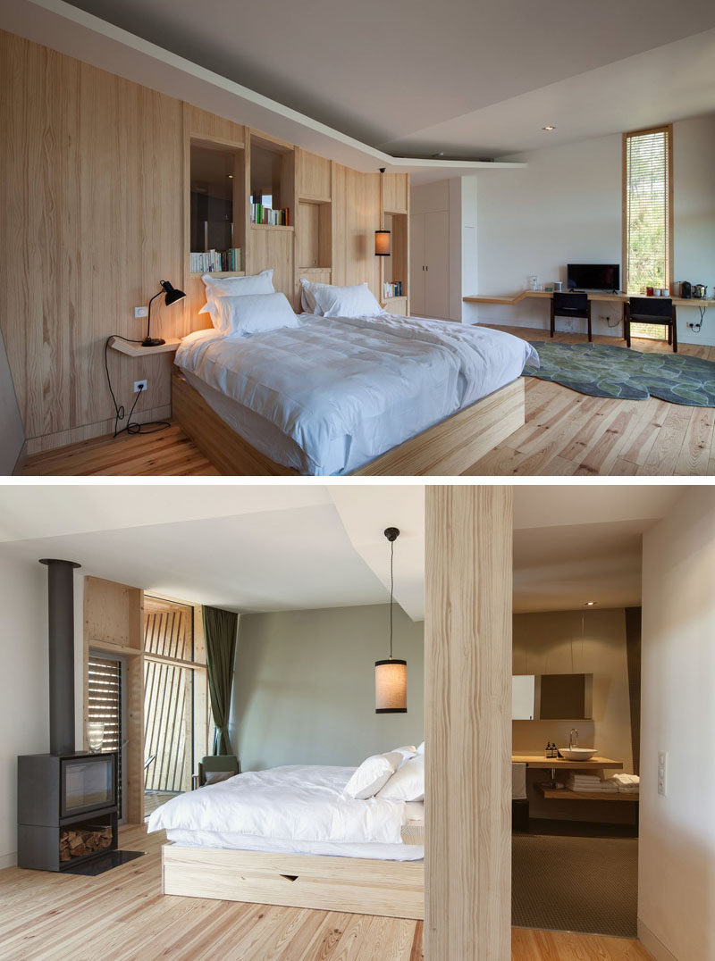 This resort room has simple wooden decor and a wood burning stove creates warmth in the winter.
