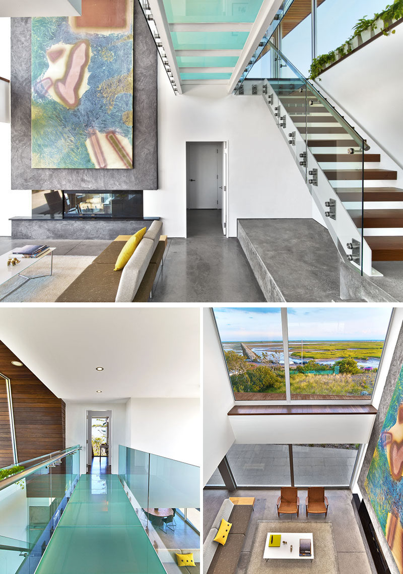 In this modern house, a glass-bridge connects the bedrooms upstairs, and provides an alternative view of the living room below and the marsh beyond.