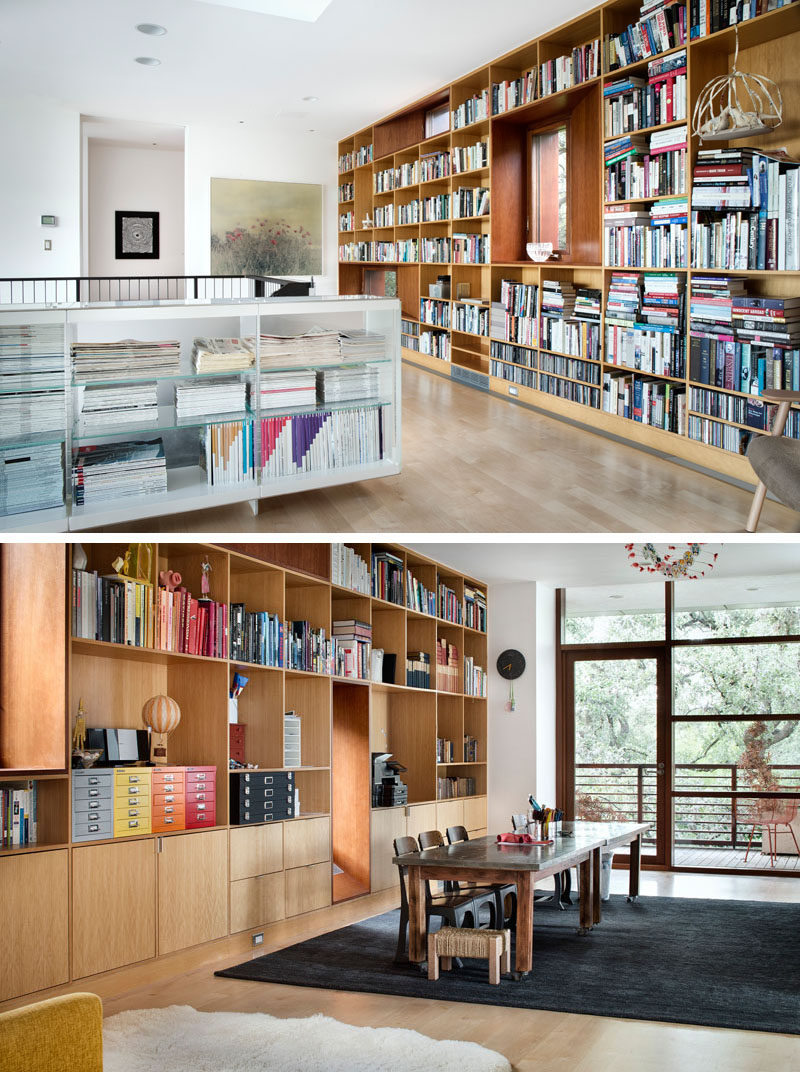 This contemporary home has a library with floor-to-ceiling built-in bookcases.