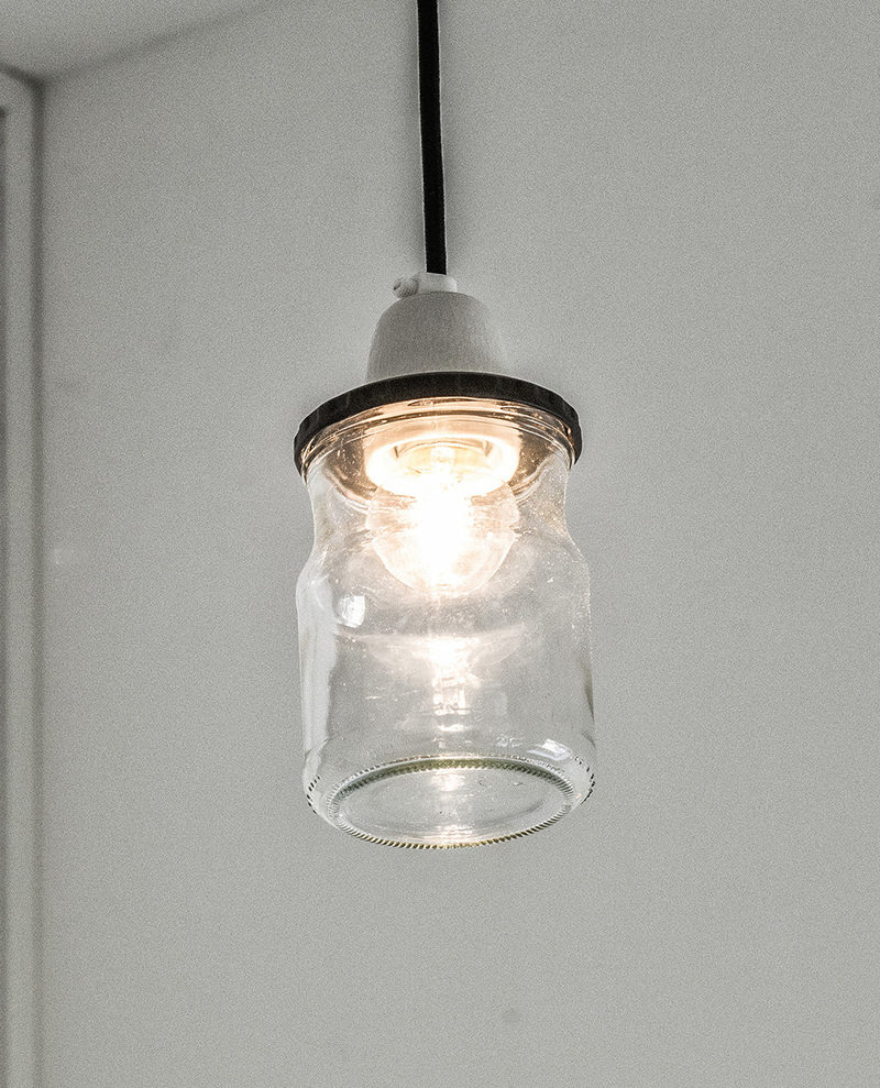 Interior Design Details - Industrial Close Ups // This small pendant light, made from a glass jar and a concrete top, brightens the space and contributes to an overall industrial vibe.