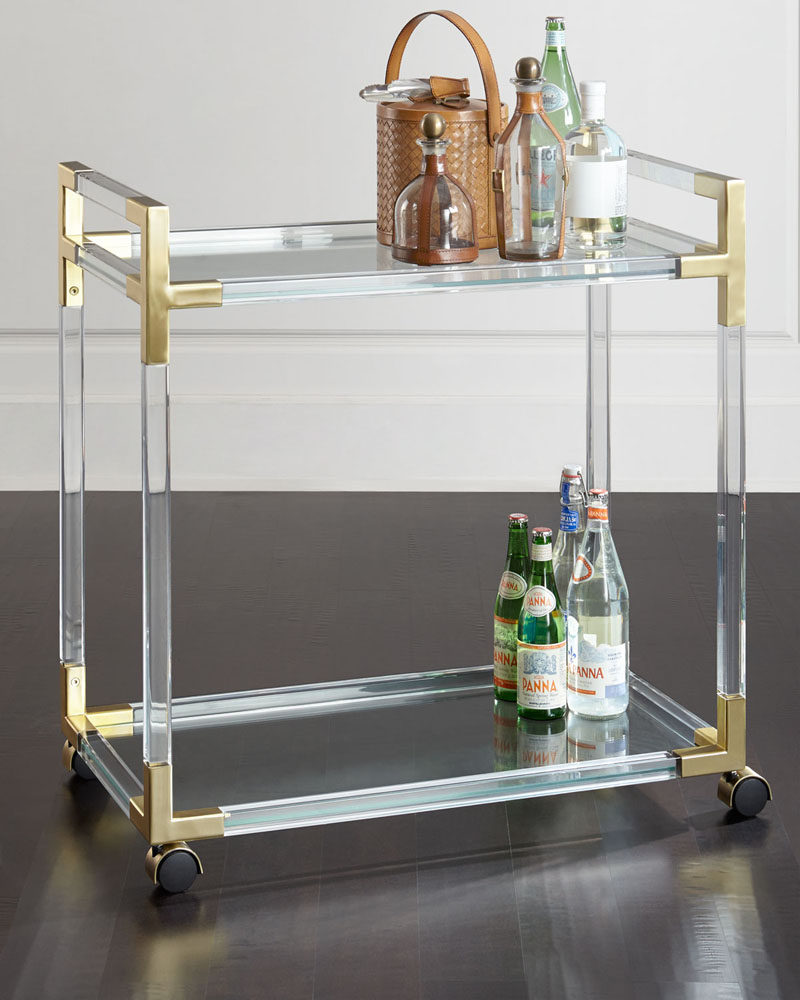 5 Ways To Use Acrylic Decor Throughout Your House // Living Room - An acrylic and brass bar cart lets guests know you're all about having a good time in style.