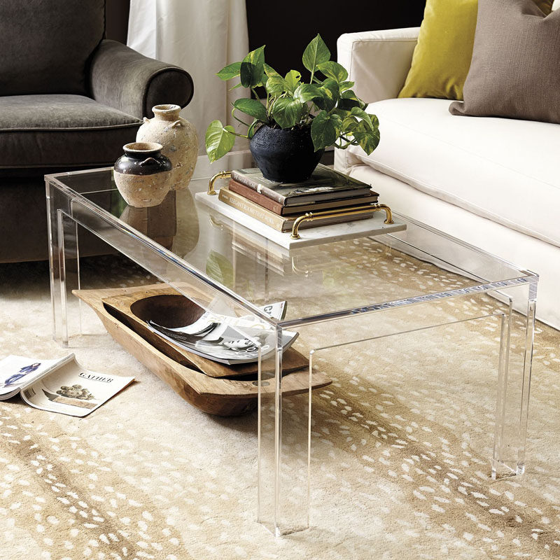 5 Ways To Use Acrylic Decor Throughout Your House // Living Room - An acrylic coffee table is one of the best things to include in an interior that's small or dark. It lets in as much light as possible and almost disappears into the rest of the decor to help the room feel bigger and more open than it actually is.