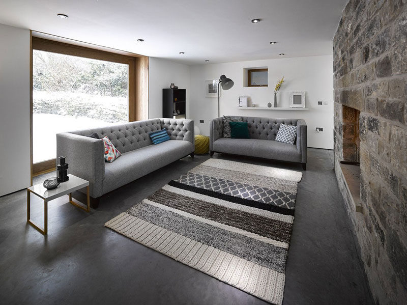 7 Ways To Create A Warm Living Room // Add a rug on the floor to make hard surfaces like tile and wood feel much warmer.