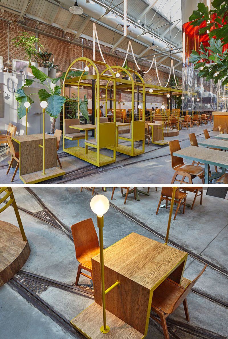 These table and chairs on a stand, have small wheels that are positioned within tram rails, giving this restaurant and bar a playful touch.