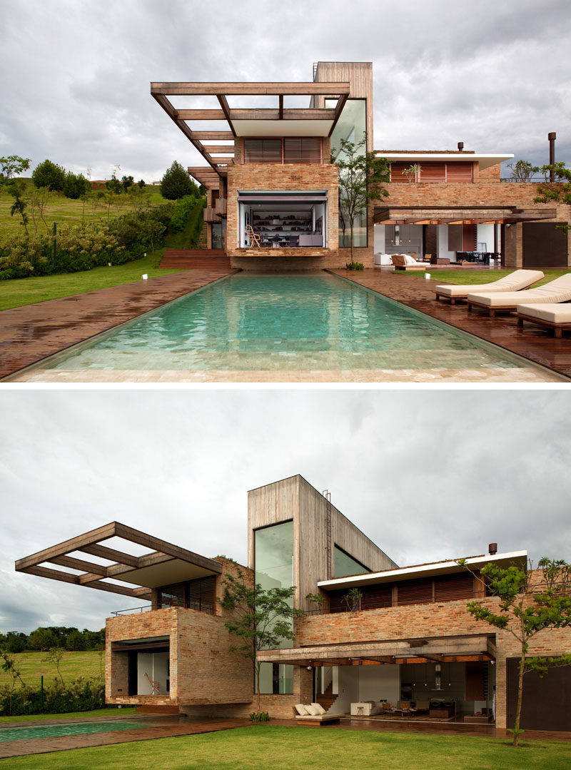 14 Modern Houses Made Of Brick // The bricks used to cover this modern home came from various torn down houses to give the bricks new life and create a more textured exterior on the house.