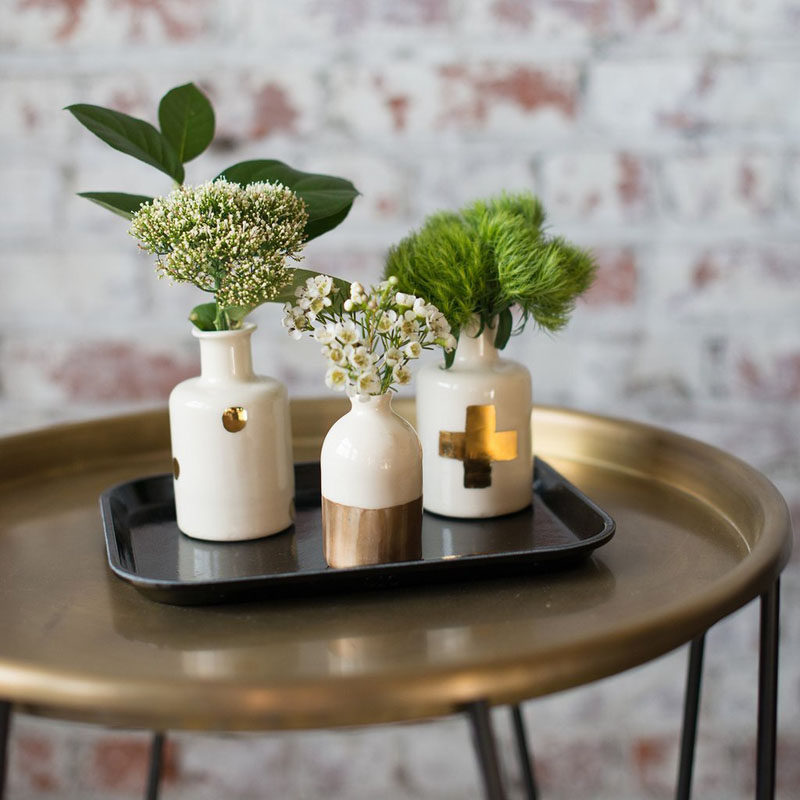 Home Decor Ideas - 6 Ways To Include Ceramic In Your Interior // Small bud vases like these white and gold ones are great for putting wild flowers or small branches in to liven up your space.