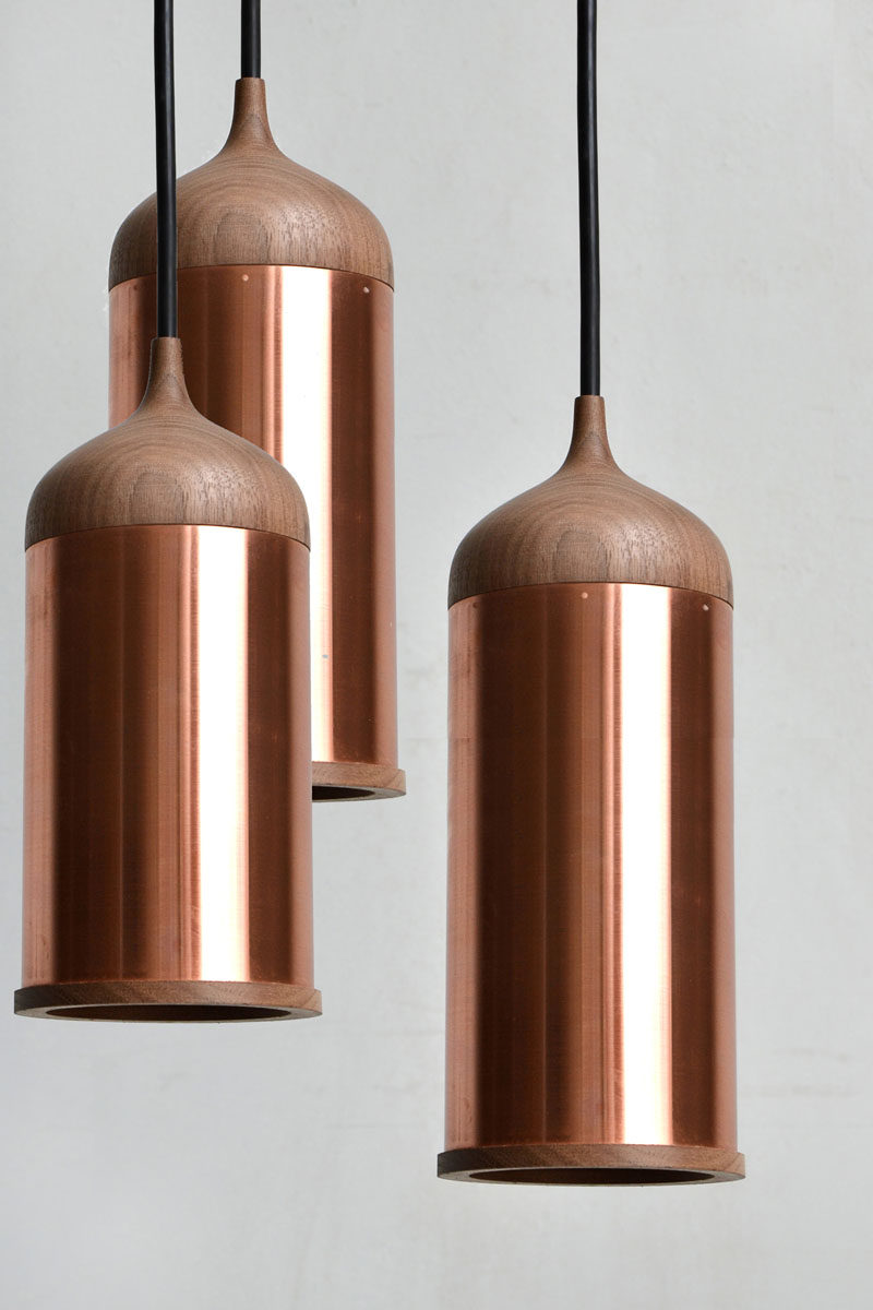Kitchen Decor Ideas - 12 Ways To Add Copper To Your Kitchen // Hang copper pendant lights above your kitchen island to provide additional light to your food prep area.