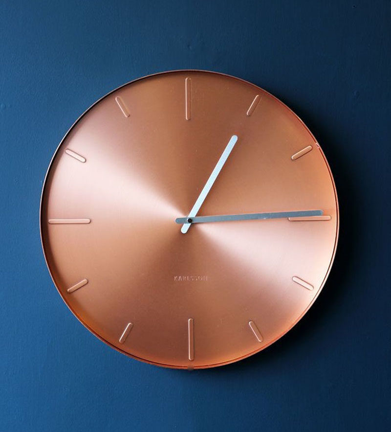Kitchen Decor Ideas - 12 Ways To Add Copper To Your Kitchen // Keep track of your time in the kitchen with a copper clock that adds shine and sophistication to the space.