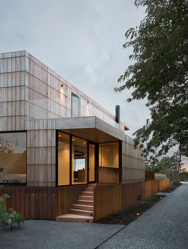 On the exterior of this home, a system of bronze bars was developed to allow the the thick cedar siding board to be attached without fastening through the wood.