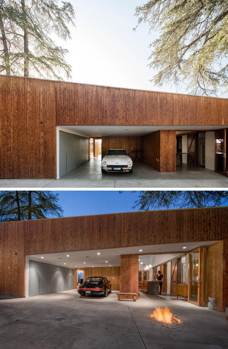Upon arriving at this contemporary Los Angeles house, there a garage that opens directly into the home. Just beside the garage is a firepit and the kitchen, that has folding doors allowing it to be open to the fire.
