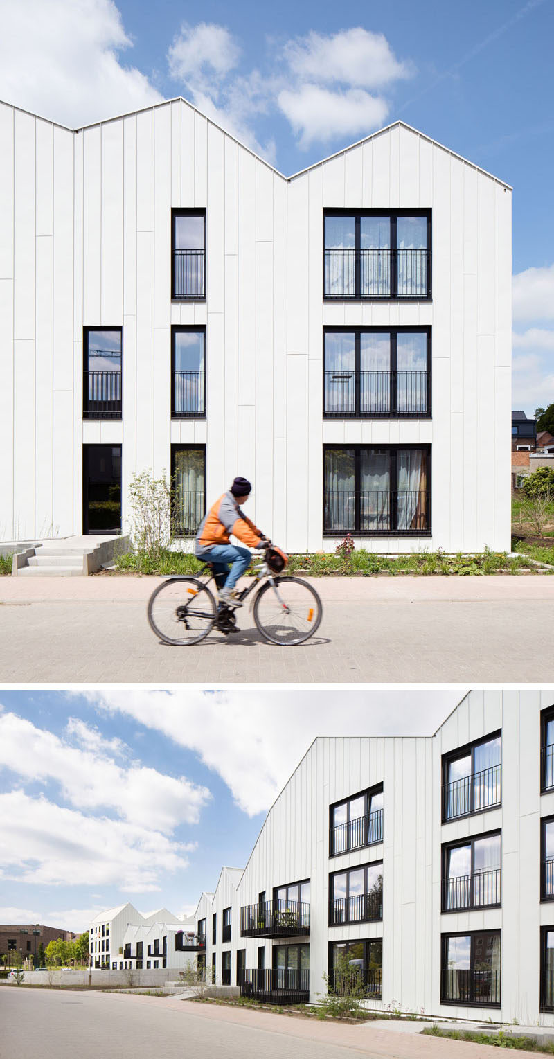 House Exterior Colors - 11 Modern White Houses From Around The World // Black window frames and balconies create a striking contrast against the white panels covering the exteriors of this row of houses.
