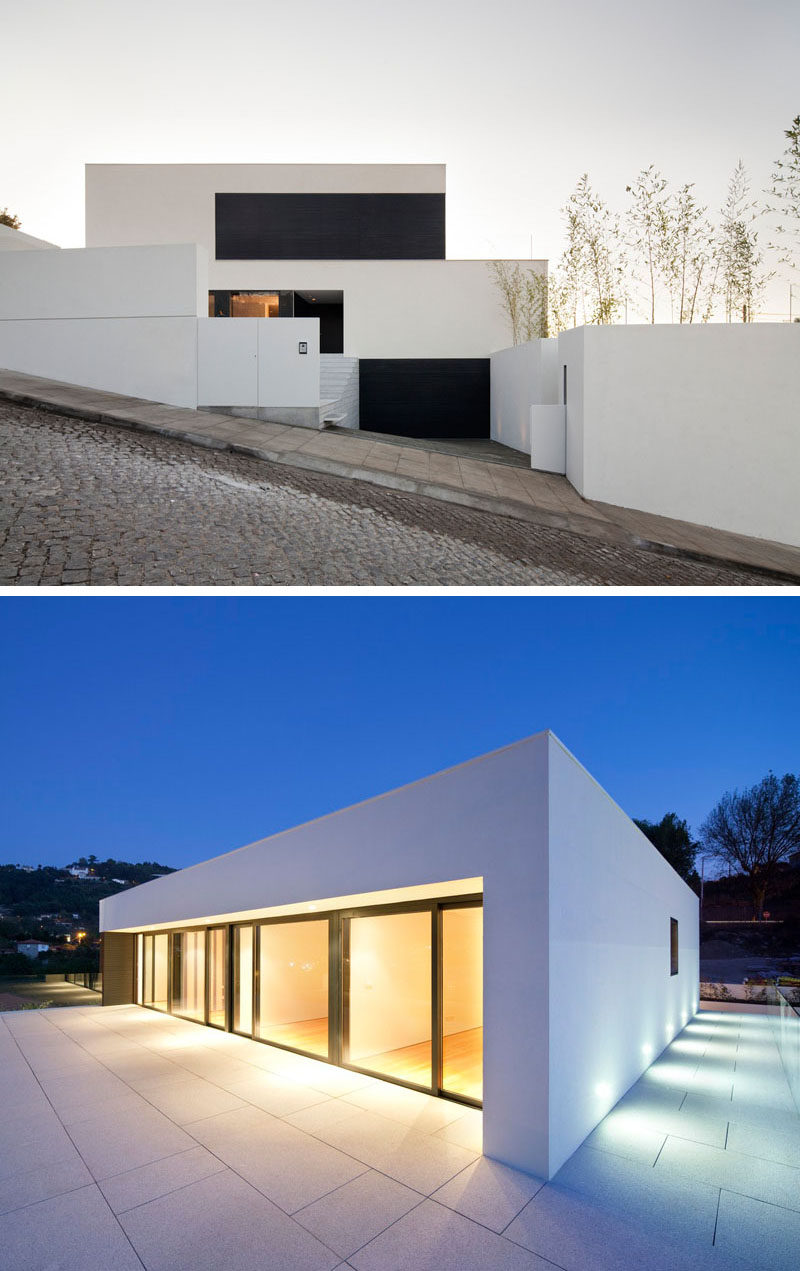 House Exterior Colors - 11 Modern White Houses From Around The World // The clean lines of this white house and it's position on a cobbled street make it look exceptionally modern.