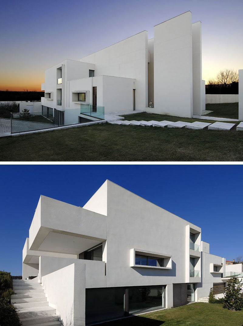 House Exterior Colors - 11 Modern White Houses From Around The World // Large white walls appear to cut through this large modern home dividing it into a number of white rectangles.