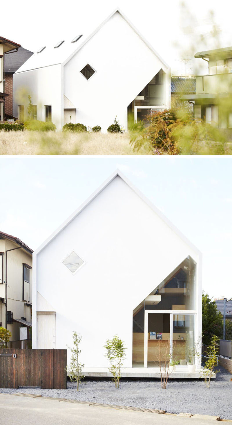 House Exterior Colors - 11 Modern White Houses From Around The World // This white house features a unique glass cutout surrounding the front door area to break up the otherwise all white exterior and brighten up the inside of the home.