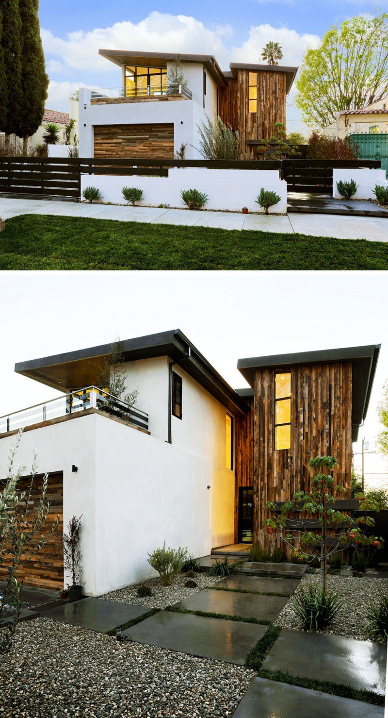 16 Examples Of Modern Houses With A Sloped Roof | The sloped roofs on this modern house, coupled with the wood paneling, gives the house a very modern look.