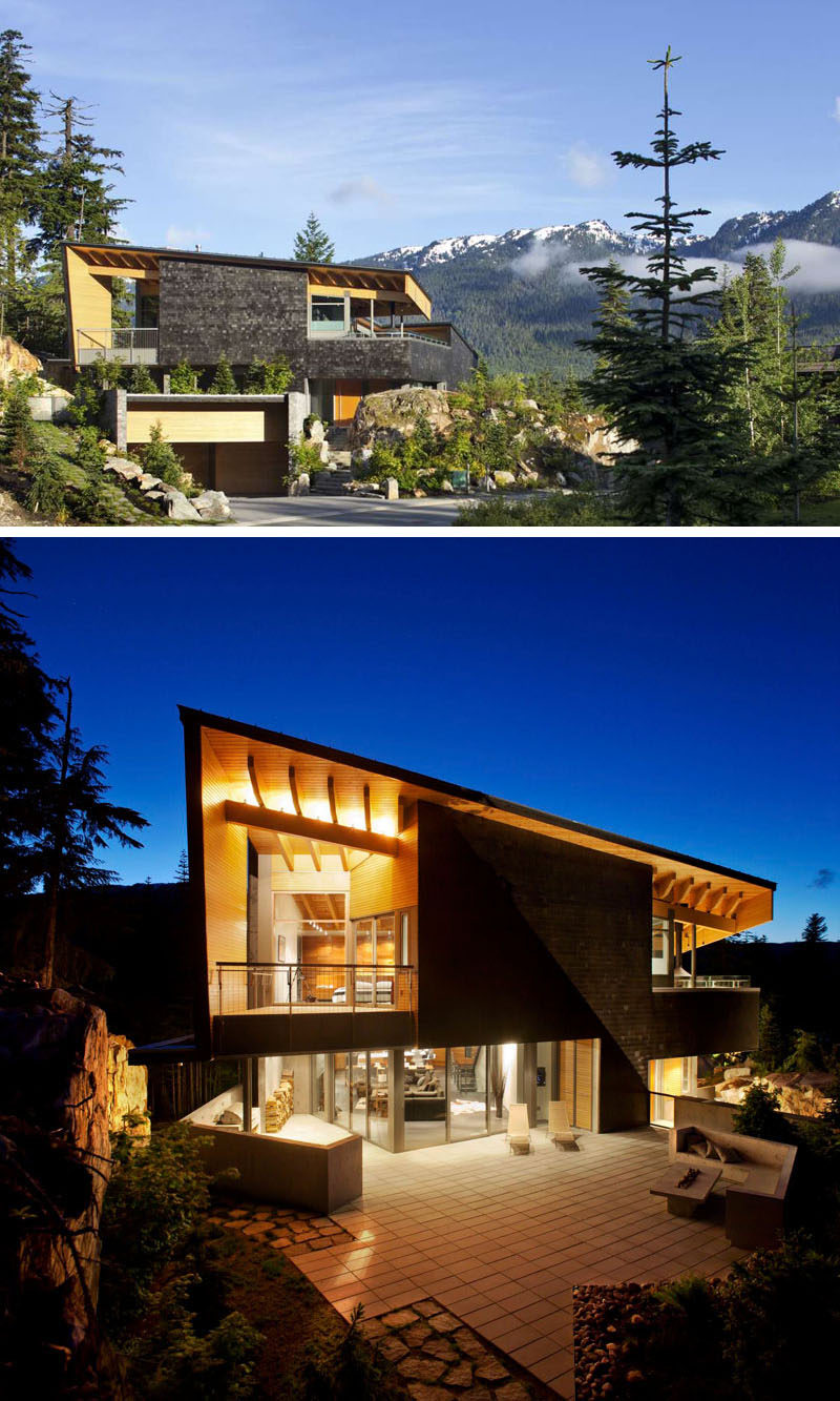 16 Examples Of Modern Houses With A Sloped Roof | The large sloped roof on this modern mountain home provides both a sense of openness as well as an element of privacy.