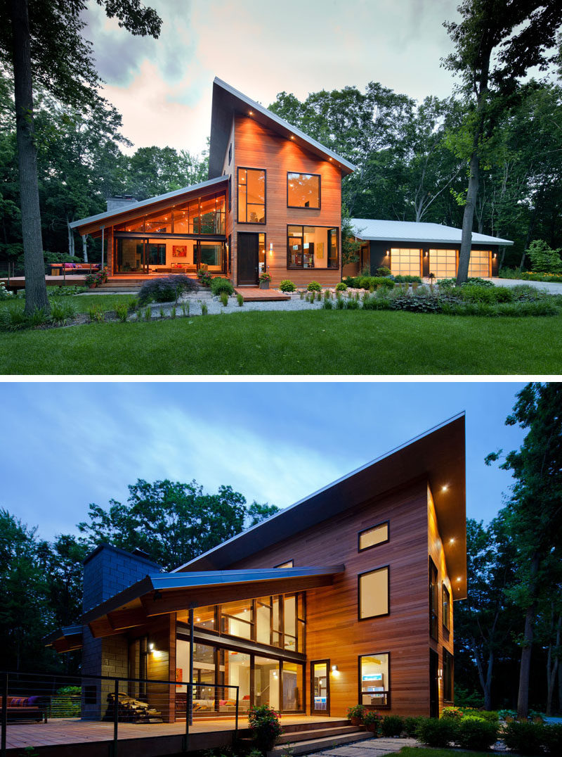16 Examples Of Modern Houses With A Sloped Roof | The sloped roofs on this wood-clad modern home promote excellent drainage and open up the house to allow to take advantage of the greenery around it.