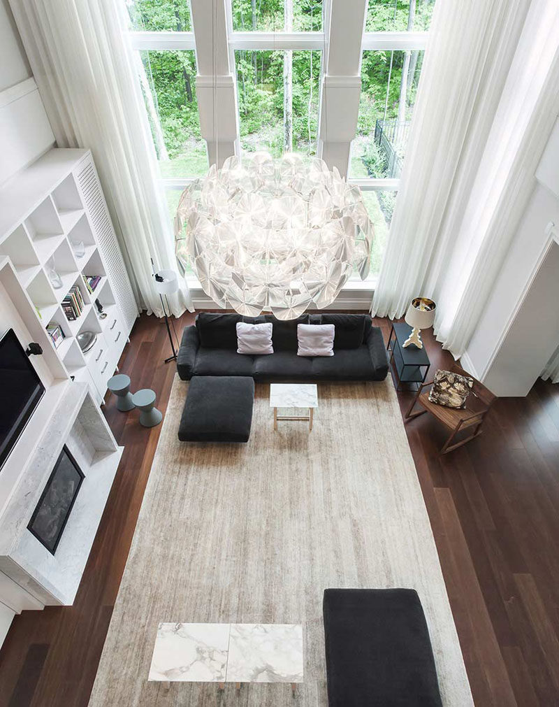Interior Design Ideas - 17 Modern Living Rooms As Seen From Above | The dark wood floors of this living room are brightened up by the tall windows and large light colored rug.