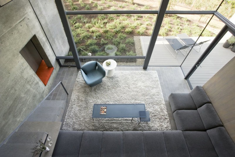 Interior Design Ideas - 17 Modern Living Rooms As Seen From Above | Walls of windows keep this neutral living room bright and inviting.