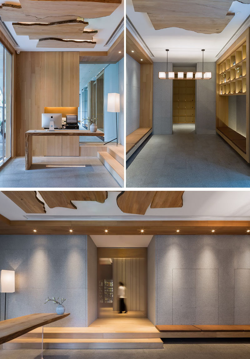 Before heading into the main dining area of this modern restaurant, there's the reception area that has a palette of grey and wood.
