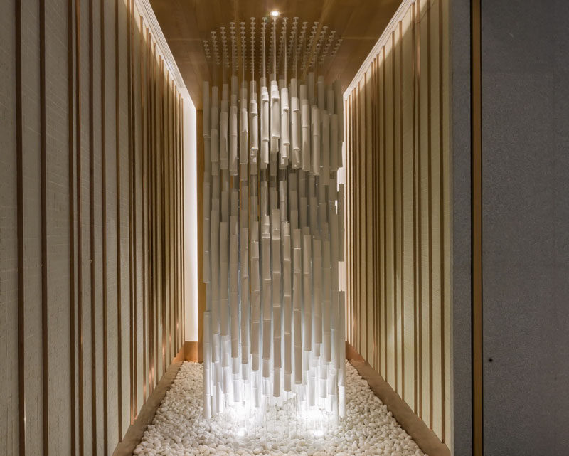 A sculptural installation of hanging bamboo and light fills a small space as you walk into this restaurant.
