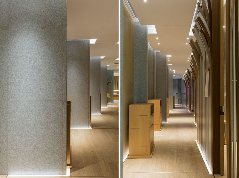 Uplighting throughout this modern restaurant highlights the edges of the walls and hallways.
