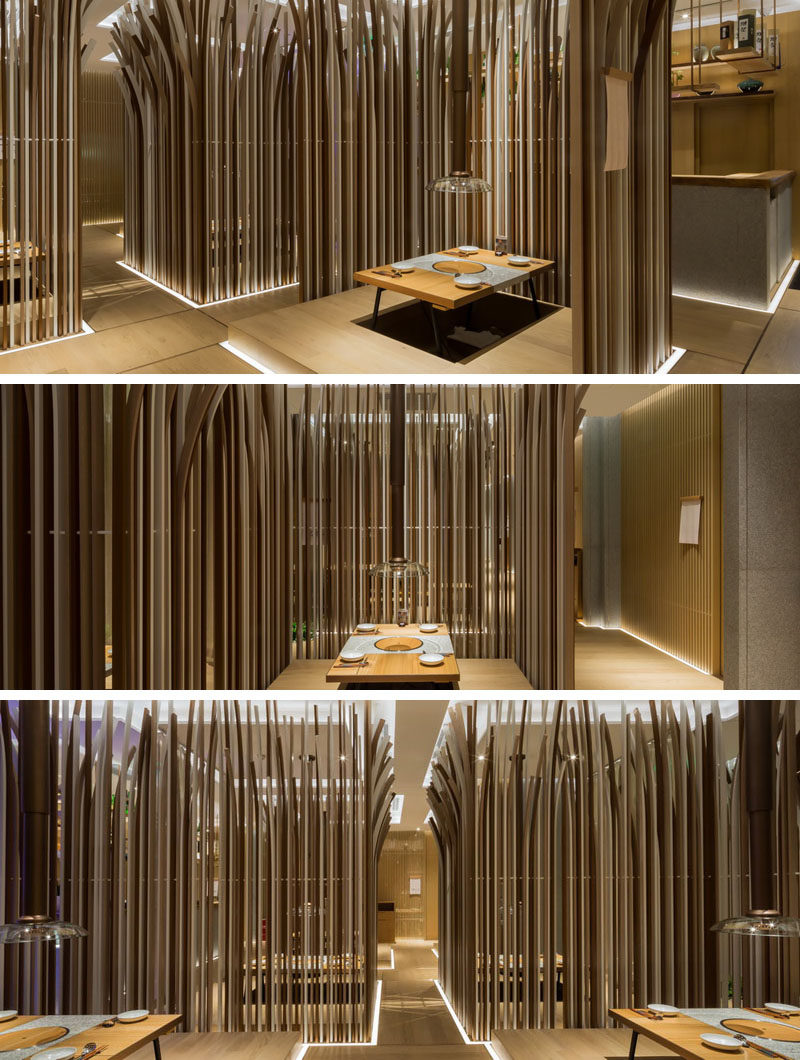 Restaurant Interior Design Ideas - This modern restaurant has a variety of 27 private tables ranging from two-person tables up to 10-people rooms for families, each semi-enclosed by tall wooden strips with curved tops to provide interest and privacy.