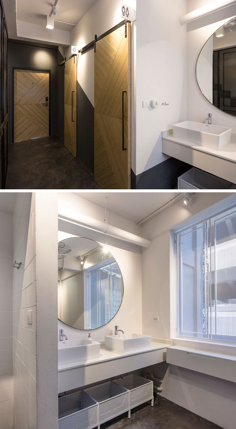 In this modern hostel in Bangkok, there's a washroom in each dormitory, with a shower, bathroom and vanity area.
