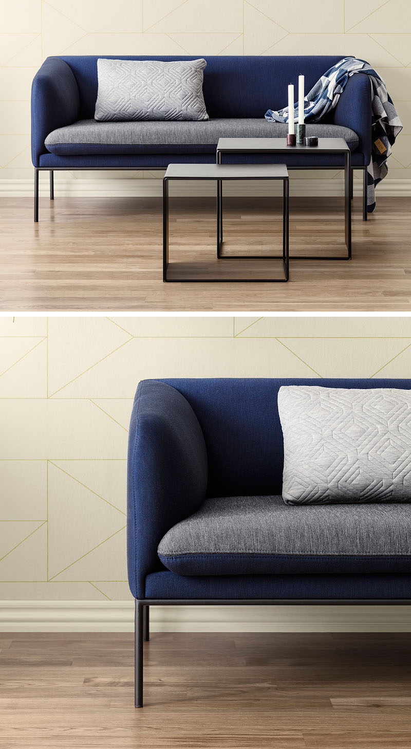 4 Ways To Use Navy Home Decor To Create A Modern Blue Living Room // If you want to add navy decor to your living room but aren't quite ready to cover your walls in the color, try adding a navy couch.