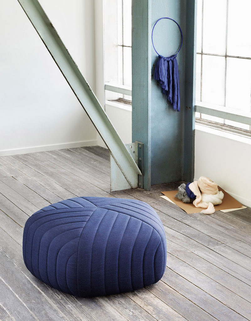4 Ways To Use Navy Home Decor To Create A Modern Blue Living Room // Poufs, arm chairs, rugs and curtains, are a great way to bring in navy without it feeling overwhelming.