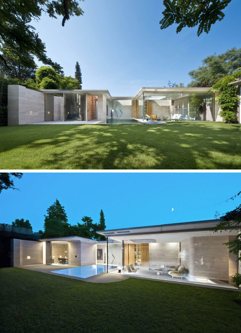 15 Single Story Modern Houses | Glass walls make up the back of this single story house to let in all the natural light and keep the home feeling bright and airy.