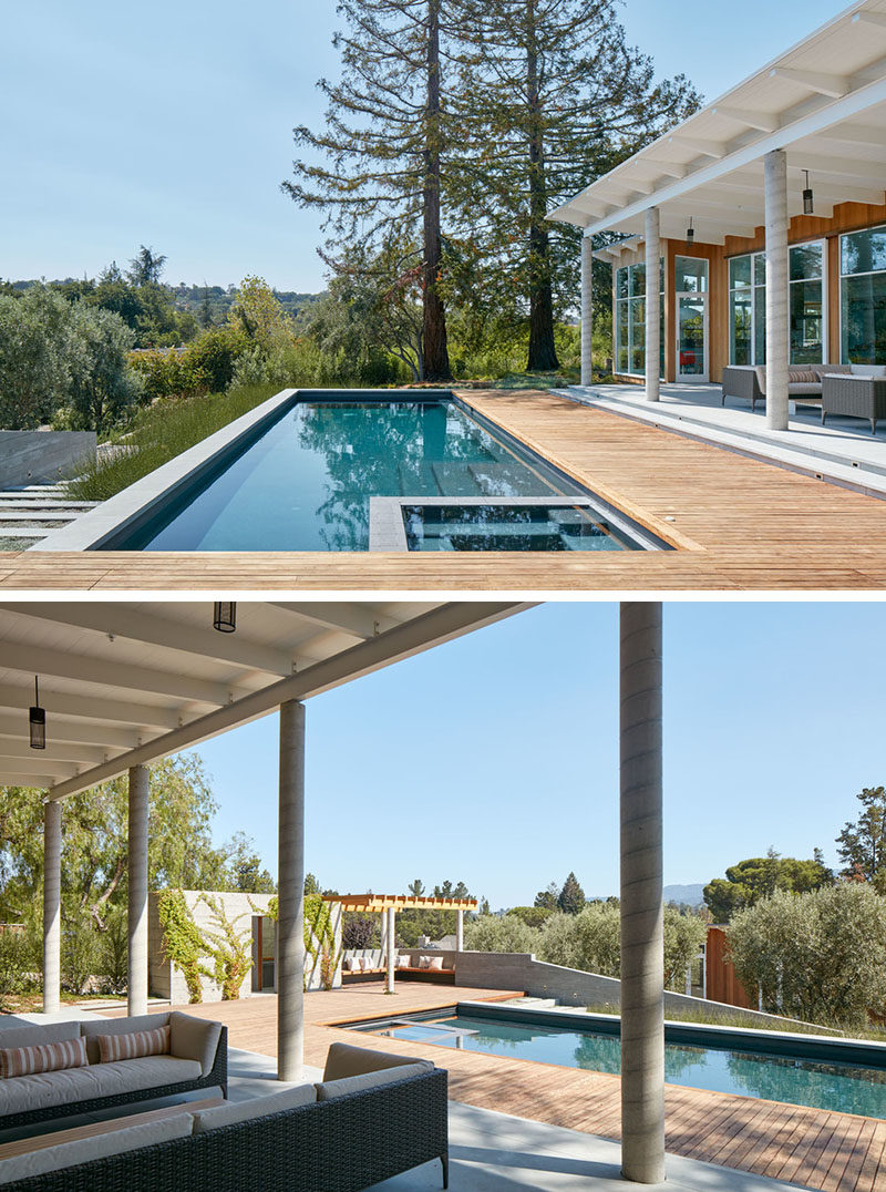 A wooden deck partially surrounds this swimming pool and provides various areas for lounging.